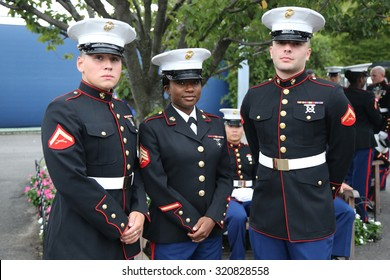 NEW YORK- SEPTEMBER 13, 2015:  United States Marine Corps officers at Billie Jean King National Tennis Center before unfurling the American flag prior US Open 2015 men's final in New York