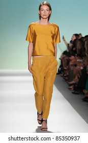 NEW YORK - SEPTEMBER 13: A model walks the runway at the TIBI S/S 2012 collection presentation during Mercedes-Benz Fashion Week on September 13, 2011 in New York