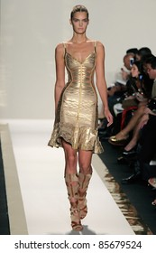 NEW YORK - SEPTEMBER 13: A model walks the runway at the Herve Leger S/S 2012 collection presentation during Mercedes-Benz Fashion Week on September 13, 2011 in New York, NY.