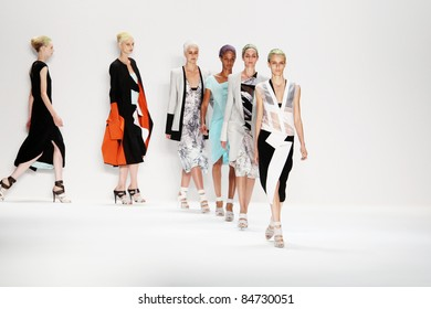 NEW YORK - SEPTEMBER 13: Models walk the runway at the Narciso Rodriguez S/S 2012 collection presentation during Mercedes-Benz Fashion Week on September 13, 2011 in New York.
