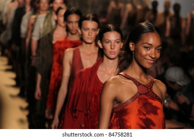 NEW YORK - SEPTEMBER 14: Models walk the runway at the Michael Kors S/S 2012 collection presentation during Mercedes-Benz Fashion Week on September 14, 2011 in New York.