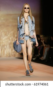 NEW YORK - SEPTEMBER 15: Model Nimue Smit walks the runway at the Anna Sui collection presentation for Spring/Summer 2011 during Mercedes-Benz Fashion Week on September 15, 2010 in New York