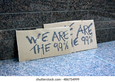 New York, New York. - September 17, 2016: Signs made by people gathered at Zuccotti Park in Lower Manhattan to mark the fifth anniversary of the Occupy Wall Street movement in 2016 in New York City