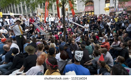 NEW YORK - SEPTEMBER 17: Protesters general assembly with 'Occupy Wall Street' movement mark one year anniversary of protest in Zuccotti Park on September 17, 2011 in New York.