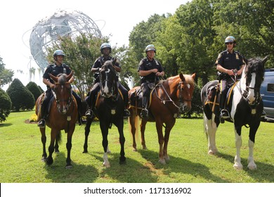 NEW YORK - SEPTEMBER 2, 2018: NYPD mounted unit police officer ready to protect public in Flushing Meadows Park in New York