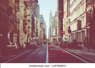 NEW YORK - SEPTEMBER 2, 2018: New York City street road in Manhattan at summer time, many cars, yellow taxis and busy people walk to work.