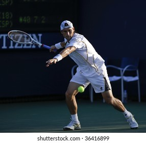 NEW YORK - SEPTEMBER 2: David Ferrer of Spain plays a shot during 1st round match against Alberto Martin of Spain at US Open on September 2, 2009 in New York.