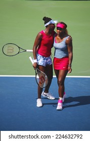 NEW YORK - SEPTEMBER 2: Grand Slam champions Serena Williams and Venus Williams during quarterfinal doubles match at US Open 2014 at National Tennis Center on September 2, 2014 in New York