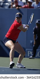 NEW YORK - SEPTEMBER 2: Kim Clijsters of Belgium plays a shot during 2nd round match against Marion Bartoli of France at US Open on September 2, 2009 in New York.