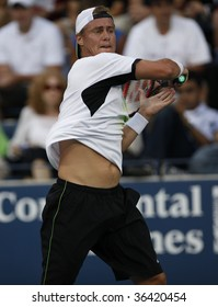 NEW YORK - SEPTEMBER 2: Lleyton Hewitt of Australia returns a shot during 2nd round match against Juan Chela of Argentina at US Open on September 2, 2009 in New York.