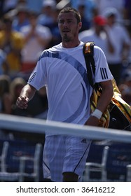NEW YORK - SEPTEMBER 2: Marat Safin leaves court for the last time in his career after losing 1st round match to Jurgen Melzer of Austria at US Open on September 2, 2009 in New York.