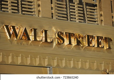NEW YORK, NEW YORK - SEPTEMBER 2017: A building in lower Manhattan proudly displays it's address location on Wall Street.