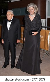 NEW YORK - SEPTEMBER 21: Dr. Henry Kissinger and his wife Nancy Kissinger arrive at the season opening of the Metropolitan Opera on September 21, 2009 in New York City.