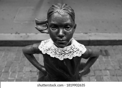 NEW YORK, NEW YORK - September 22, 2020: The 'Fearless Girl' statue by Kristen Visbal in front of the New York Stock Exchange wearing a lace collar in tribute to Justice Ruth Bader Ginsburg.