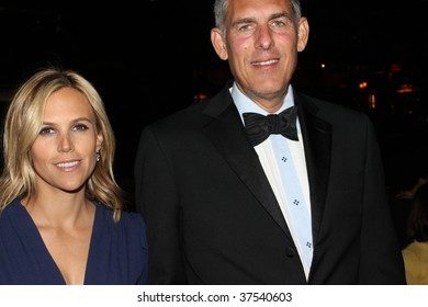 NEW YORK - SEPTEMBER 22: CEO of NA Warner Music Group Lyor Cohen (R) arrives with Tory Burch (L) at the New Yorkers For Children 10th Annual Fall Gala at Cipriani 42 on September 22, 2009 in New York.