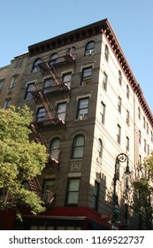 """New York, New York - September 22nd, 2017: """"Friends"""" apartment with cafe below, a popular tourist spot for all fans of the long lasting show."""