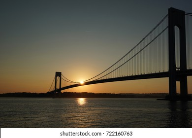 NEW YORK - SEPTEMBER 24, 2017: Verrazano Bridge at sunset in New York.The Verrazano Bridge is a double-decked suspension bridge that connects the boroughs of Staten Island and Brooklyn