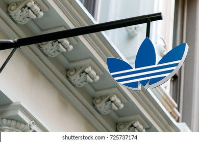 New York, September 25, 2017: Adidas logo is suspended above the entrance to their store in SoHo.