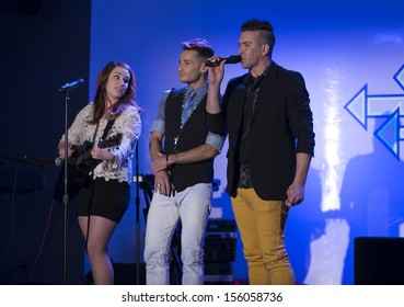 NEW YORK - SEPTEMBER 27: Emmy Hunton (L) & Frankie Grande (C) perform on stage at 2013 Bailey House Fundraiser at LQNY on September 27, 2013 in New York City.