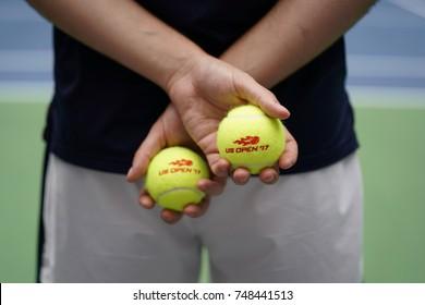 NEW YORK - SEPTEMBER 3, 2017: Ball boy holding tennis balls at the Billie Jean King National Tennis Center during US Open 2017