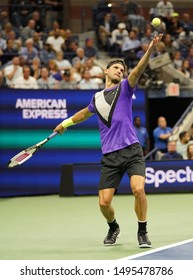NEW YORK - SEPTEMBER 3, 2019: Professional tennis player Grigor Dimitrov of Bulgaria in action during the 2019 US Open quarter-final match against 20-time Grand Slam champion Roger Federer