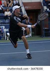 NEW YORK - SEPTEMBER 3: Bryan of USA returns a shot during 1st round doubles match against Jose Acasuso and Martin Arguello of Argentina at US Open on September 3, 2009 in New York.