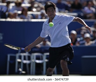 NEW YORK - SEPTEMBER  3: Kevin Kim of USA returns a shot during 2nd round match against Sam Querrey of USA at US Open on September 3, 2009 in New York.