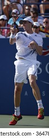 NEW YORK - SEPTEMBER  3: Sam Querrey of USA returns a shot during 2nd round match against Kevin Kim of USA at US Open on September 3, 2009 in New York.