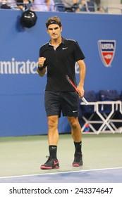 NEW YORK - September 4, 2014: Seventeen times Grand Slam champion Roger Federer during quarterfinal match at US Open 2014 against Gael Monfils at Arthur Ashe Stadium in New York