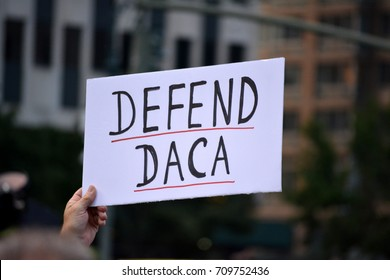 New York, New York - September 5, 2017: People carrying signs protesting President Trump's decision to repeal the Deferred Action for Childhood Arrivals (DACA) policy in Lower Manhattan.