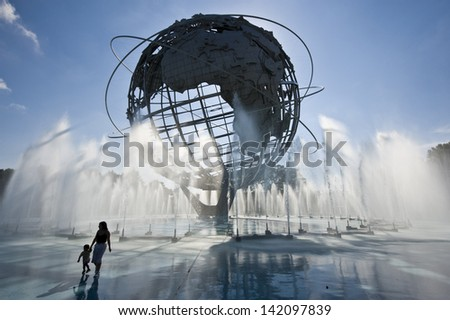 NEW YORK - SEPTEMBER 5: A mother and child at the Unisphere in Flushing Meadows Park on September 5, 2008 in New York. Built for the 1964 World's Fair, it now hosts the US Open tennis championship.