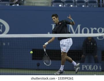 NEW YORK - SEPTEMBER 5: Novak Djokovic of Serbia returns ball during quarterfinal match against Mikhail Youzhny of Russia  at USTA Billie Jean King National Tennis Center on September 5, 2013 in NYC