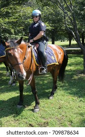 NEW YORK - SEPTEMBER 5,2017: NYPD mounted unit police officer ready to protect public in Flushing Meadows Park in New York
