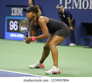 NEW YORK - SEPTEMBER 6, 2018: Professional tennis player Naomi Osaka in action during her 2018 US Open semi-final match at Billie Jean King National Tennis Center
