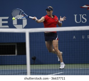 NEW YORK - SEPTEMBER 6: Kim Clijsters of Belgium returns a shot during 3rd round match against Venus Williams of USA at US Open on September 6, 2009 in New York.