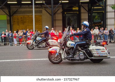 """NEW YORK - SEPTEMBER 6: Participants of the 76th Annual Pulaski Day Parade held on September 6, 2013 in New York. Theme for this year Parade was: """"March March Polonia, March Brave Nation""""."""