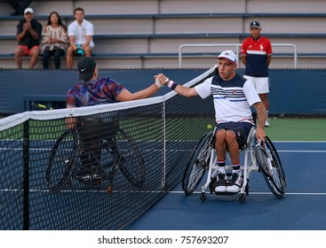 NEW YORK - SEPTEMBER 7, 2017:Wheelchair tennis player Andrew Lapthorne of Great Britain (R) celebrates victory after his Wheelchair Quad Singles semifinal match at US Open 2017