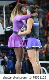NEW YORK - SEPTEMBER 7, 2019: Finalist Serena Williams (L) and 2019 US Open champion  Bianca Andreescu of Canada during trophy presentation at Billie Jean King National Tennis Center in New York