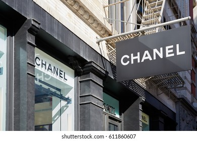 NEW YORK - SEPTEMBER 7: Chanel shop sign and window exterior view in 139 Spring St, Soho in a sunny day on September 7, 2016 in New York. Chanel is a fashion house founded in 1909.