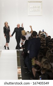 NEW YORK - SEPTEMBER 7: Max and Lubov Azria salute the audience at the Herve Leger by Max Azria fashion show during Mercedes-Benz Fashion Week Spring Summer 2014 on SEPTEMBER 7, 2013 in New York