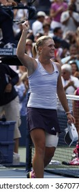 NEW YORK - SEPTEMBER 7 : Melanie Oudin of USA celebrates victory in 4th round match against Nadia Petrova of Russia at US Open on September 7, 2009 in New York.