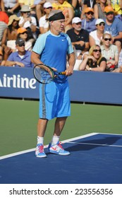 NEW YORK - SEPTEMBER 7 Seven times Grand Slam champion John McEnroe during US Open 2014 champions exhibition match at Billie Jean King National Tennis Center on September 7, 2014 in New York
