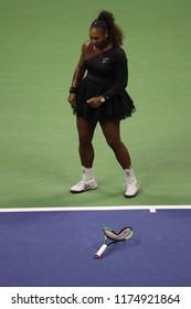 NEW YORK - SEPTEMBER 8, 2018: 23-time Grand Slam champion Serena Williams broke tennis racket during her 2018 US Open final match at Billie Jean King National Tennis Center
