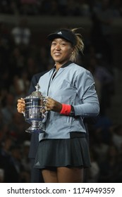 NEW YORK - SEPTEMBER 8, 2018: 2018 US Open champion Naomi Osaka of Japan of United States posing with US Open trophy during trophy presentation after her final match victory against Serena Williams