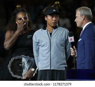 NEW YORK - SEPTEMBER 8, 2018: 2018 US Open finalist Serena Williams of United States and champion Naomi Osaka of Japan during trophy presentation women's  final match at Billie Jean King Tennis Center