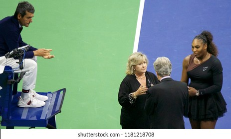 NEW YORK - SEPTEMBER 8, 2018: Serena Williams argues with chair umpire Carlos Ramos (L), ITF commissar Donna Kelsey (L) and tournament referee Brian Earley during her 2018 US Open women's final match