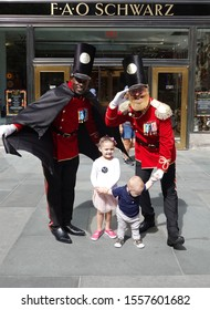 NEW YORK - SEPTEMBER 8, 2019: A doormen dressed as a toy soldier stand outside newly reopened the FAO Schwarz flagship store at Rockefeller Plaza in Midtown Manhattan