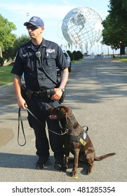 NEW YORK - SEPTEMBER 8, 2106: NYPD transit bureau K-9 police officer and K-9 dog providing security at National Tennis Center during US Open 2016 in New York