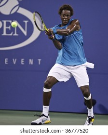 NEW YORK - SEPTEMBER 8: Gael Monfils of France returns a shot during 4th round match against Rafael Nadal of Spain at US Open on September 8, 2009 in New York