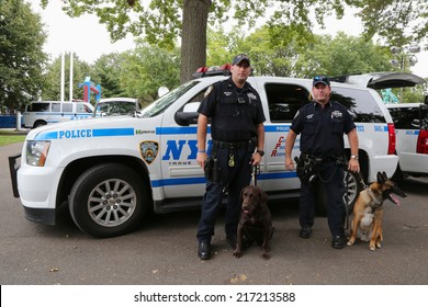 NEW YORK - SEPTEMBER 8: NYPD transit bureau K-9 police officers and K-9 dogs providing security at National Tennis Center during US Open 2014 on September 8, 2014 in New York